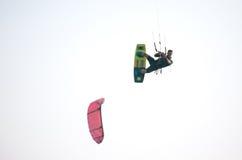 Kiteboarder athlete performing kiteboarding kitesurfing tricks. Unhooked Stock Photo