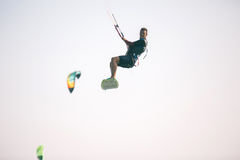 Kiteboarder athlete performing kiteboarding kitesurfing tricks. Unhooked royalty free stock photography