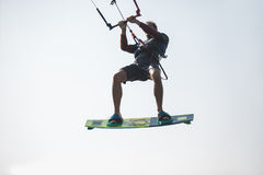 Kiteboarder athlete performing kiteboarding kitesurfing tricks. Unhooked stock photography