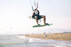 Kiteboarder athlete performing kiteboarding kitesurfing tricks. Unhooked Royalty Free Stock Images