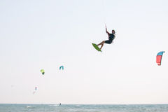 Kiteboarder athlete performing kiteboarding kitesurfing tricks. Unhooked Royalty Free Stock Image
