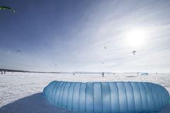 Kiteboarder with blue kite on the snow Stock Photos