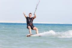 Kiteboarder enjoying surfing royalty free stock photography