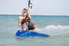 Kiteboarder enjoying surfing royalty free stock images