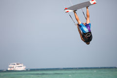 Kiteboarder high air. Kiteboarder enjoy surfing in blue water and jumps high in the air Royalty Free Stock Photos