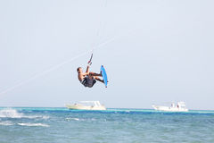 Kiteboarder jumps Stock Image