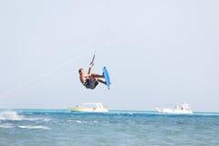 Kiteboarder jumps stock image