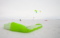 Kiteboarder with kite on the snow Royalty Free Stock Image