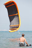 Kiteboarder lifting kite Royalty Free Stock Image