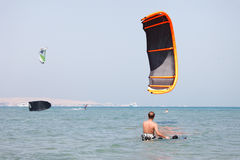 Kiteboarder lifting kite Royalty Free Stock Photo