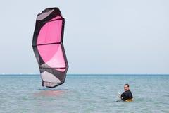 Kiteboarder lifting kite royalty free stock image