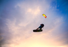 Kiteboarder performing a jump against sky Royalty Free Stock Photo