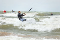 Kiteboarder surfing Stock Photo