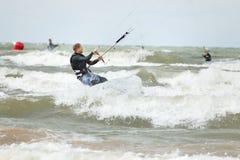 Kiteboarder surfing stock photo