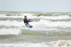 Kiteboarder surfing stock image