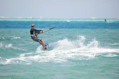 Kiteboarder surfing Royalty Free Stock Photos