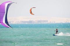 Kiteboarder surfing Royalty Free Stock Photo