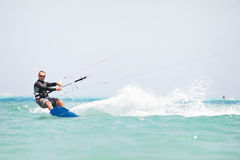 Kiteboarder surfing Stock Images