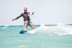 Kiteboarder surfing Royalty Free Stock Photos