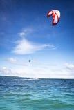 Kiteboarder on surfing on sea. Kite boarder on surfing on beautiful sea Stock Image