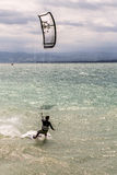 Kiteboarder surfing waves with kiteboard. On bodensee Royalty Free Stock Image