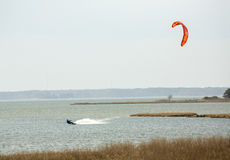 Kiteboarder surfs on Sinepuxent Bay off Assateague Island, Maryl Royalty Free Stock Images