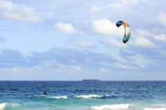 Kiteboarder and Tanker Cargo Boat royalty free stock photo
