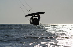 Kiteboarder upside down jump. Late afternoon stock photos