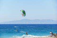 Kiteboarding on Aegean Sea. Peoples doing kiteboarding in Aegean Sea , Rhodes Greece Royalty Free Stock Photo