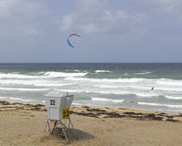 Kiteboarding along empty ocean beach Royalty Free Stock Photos