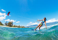 Kiteboarding. Attractive Young Woman KiteBoarding, Fun in the ocean, Extreme Sport Kitesurfing Stock Images