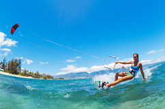 Kiteboarding. Attractive Young Woman KiteBoarding, Fun in the ocean, Extreme Sport Kitesurfing Stock Photography