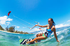 Kiteboarding. Attractive Young Woman KiteBoarding, Fun in the ocean, Extreme Sport Kitesurfing Stock Photos