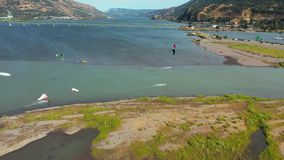 Hood River Kite Boarding. KITEBOARDING IS THE closest most of us humans will ever get to flying, and the Columbia River Gorge, a chasm lined with luscious stock footage