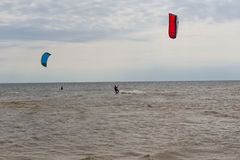 Kiteboarding at cloudy day Royalty Free Stock Photo