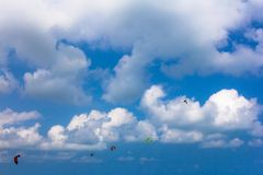 Kiteboarding competition, kites in the sky Stock Image