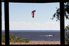 Kiteboarding at the gulf of finland. Extreme water sport - kiteboarding at the gulf of finland at summer sunny day Stock Photos