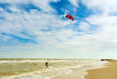 Kiteboarding. A kite surfer rides the waves. Holidays on nature. royalty free stock images