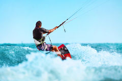 Kiteboarding, Kitesurfing. Water Sports. Kitesurf Action On Wave Royalty Free Stock Photography