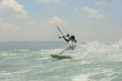 Kiteboarding on  a Mediterranean sea coast Royalty Free Stock Photo
