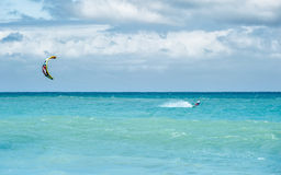 Kiteboarding in ocean. At clean summer day Stock Photos