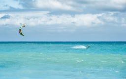 Kiteboarding in ocean Stock Photos
