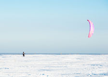 Kiteboarding or snow kite. On winter field Royalty Free Stock Image