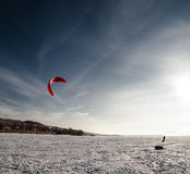 Kiteboarding on snow Royalty Free Stock Images