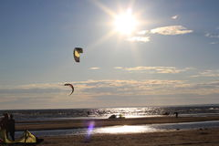 Kiteboarding , sun and beach or nature. Beautiful kites , sun is shining brightly, beach of Ladoga lake in Russia royalty free stock images