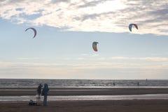 Kiteboarding , sun and beach or nature. Beautiful kites , sun is shining brightly, beach of Ladoga lake in Russia stock photography