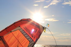 Kiteboarding , sun and beach or nature. Beautiful kites , sun is shining brightly, beach of Ladoga lake in Russia Royalty Free Stock Image