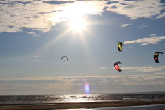 Kiteboarding , sun and beach or nature. Beautiful kites , sun is shining brightly, beach of Ladoga lake in Russia Stock Image