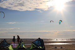Kiteboarding , sun and beach or nature. Beautiful kites , sun is shining brightly, beach of Ladoga lake in Russia stock photo