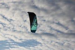 Kiteboarding , sun and beach or nature. Beautiful kites , sun is shining brightly, beach of Ladoga lake in Russia stock image